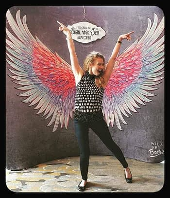 Sue Brown-Moore with angel wings at Coastal Magic 2020